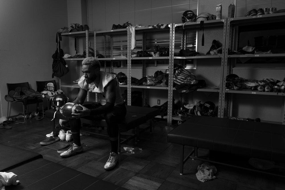 a locker room Environmental Portrait of Sean Draper