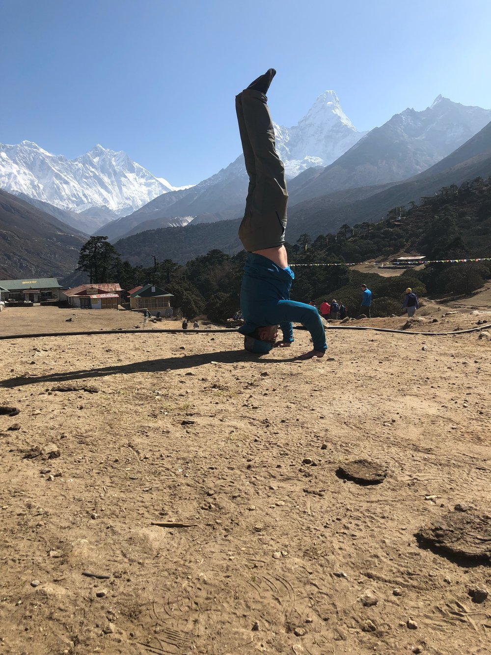 Crow to headstand with Ama Dablam in the background.png