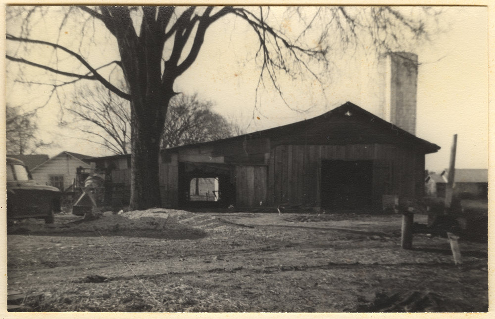 1951 - Outbuilding and silo on the Chaney family farm. The silo still stands today, though it is no longer used.