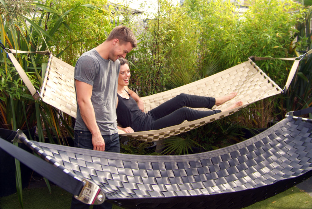 Navy blue and champagne taupe Ting Sling seatbelt hammocks featured in exterior environment.