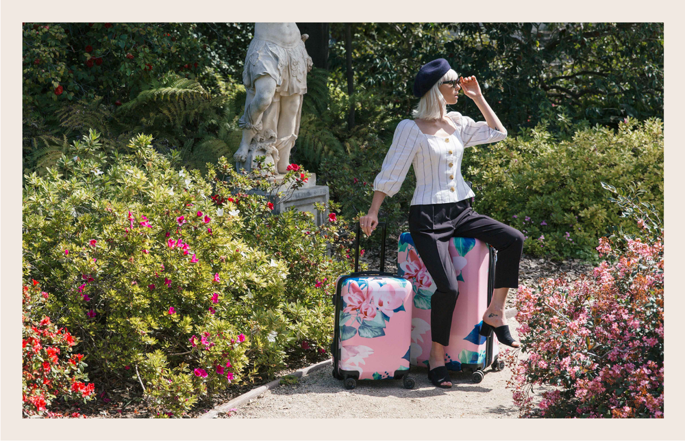 CALPAK 2 Piece Flora Luggage with Model in a garden