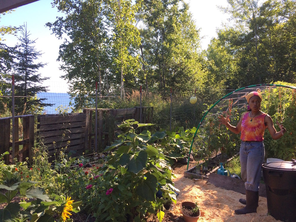 Regina Explaines in Garden on Shore.jpg