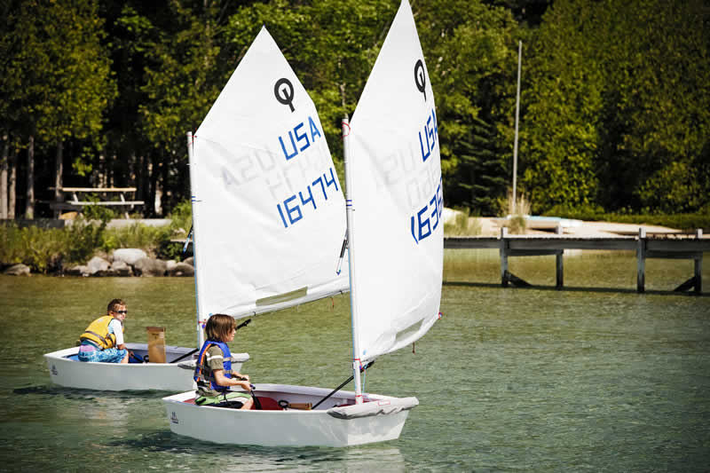 Originally designed in 1947, the Optimist Dinghy has become the world standard as both the introductory junior trainer and a premier one design racing class. It is the only sailboat designed specifically for children allowing them to learn the essentials of sailing without danger or fear. It is also the biggest and fastest growing racing class in the world with over 300,000 hulls built worldwide.