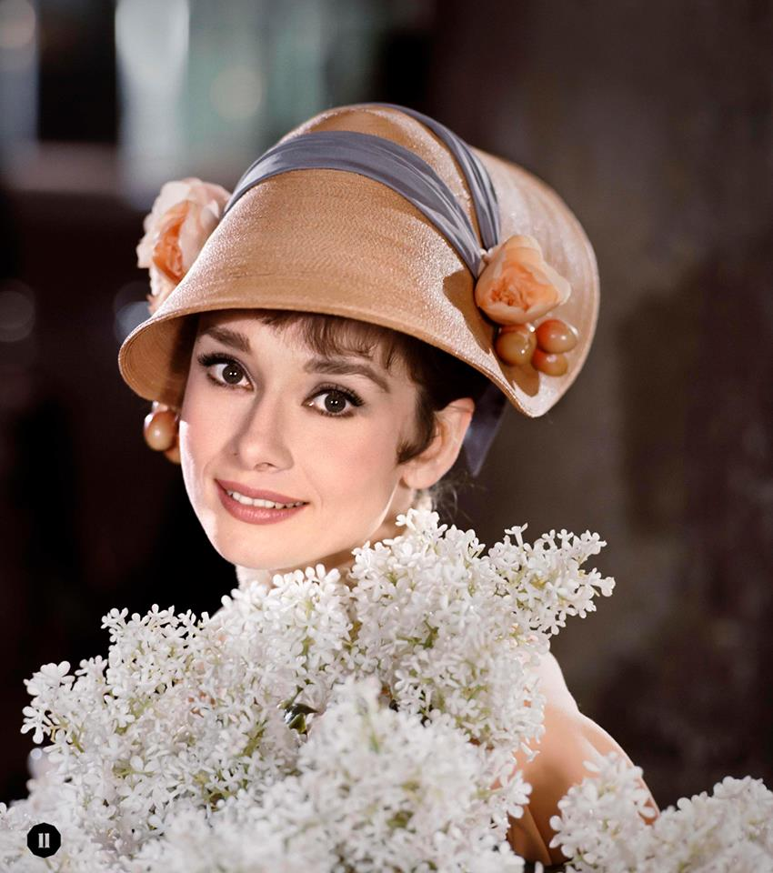 """""""Are there lilac trees in the heart of town?"""": Audrey poses with white lilacs for My Fair Lady, 1963 ©BOBWILLOUGHBY"""