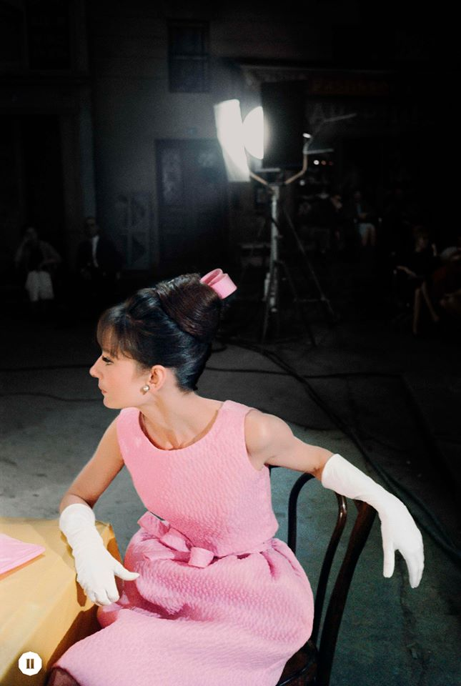 Audrey wears a pink dress with matching ribbon and elegant white gloves, 1962 ©BOBWILLOUGHBY