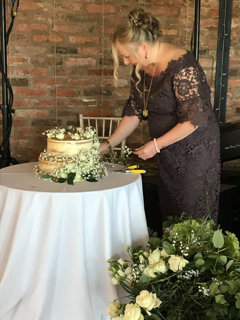 The Mother-of-the-Bride is making a fabulous job of decorating the cake! Well done MOTB!