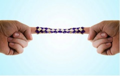 """A Chinese finger trap as an example of trying to stretch a """"tense"""" muscle."""