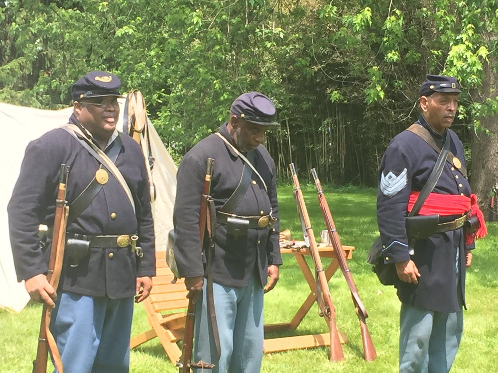Chuck Monroe (left), Alfonso McRay (center), and Algernon Ward (right) of the 6th Regiment Infantry USCT Reenactors demonstrate regimental formations.