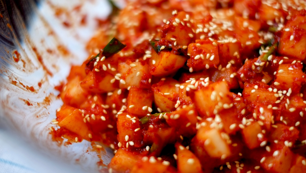 Crunchy, spicy and slightly sour, radish kimchi will definitely whet your  appetite