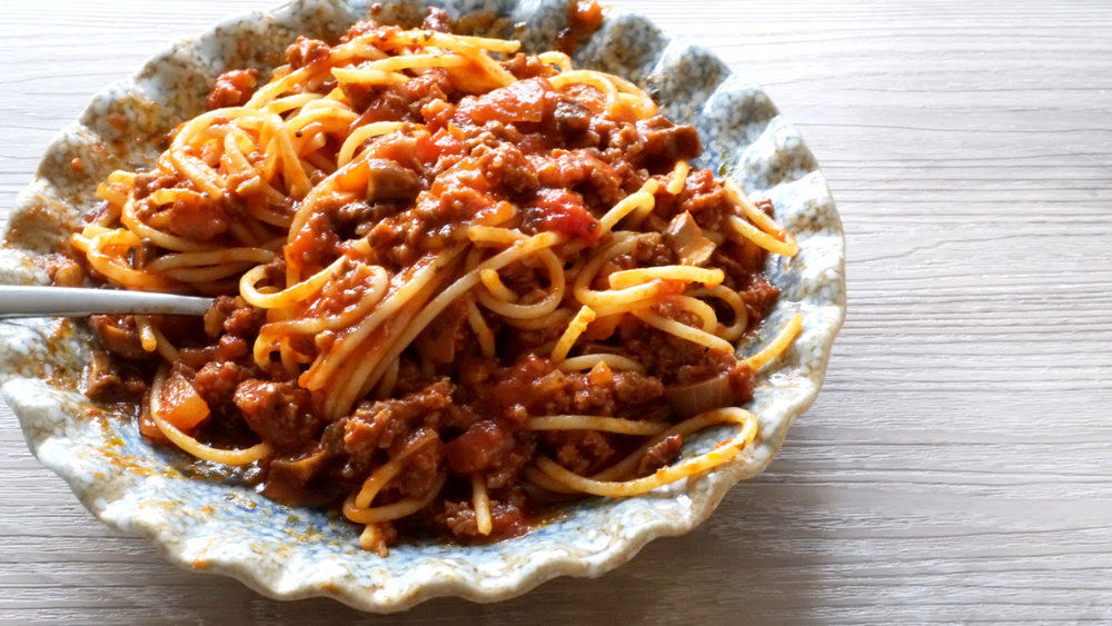 Quick and Easy Spaghetti Bolognese   Prep time: 5 mins  Cook time: 15 mins  Total time: 20 mins  Serves: 4     Ingredients:   · Enough Spaghetti for 4 people  · 24oz Pasta Sauce (any brand)  · 1 pound Ground Beef  · 5-6 Baby Portobello Mushrooms, diced  · 4 cloves Garlic, minced  · 1 medium Onion, diced  · 3 tablespoons Tomato Ketchup  · 2 tablespoons Brown Sugar  · 1 cup Pasta Water, reserved     Instructions   1) Cook the spaghetti according to package instructions.  2) While the pasta is cooking, prepare the ingredients for the sauce by dicing up  the mushrooms and onion, and mince the garlic.  3)                                                                              Heat up 3 tablespoons of Olive Oil in a medium saucepot or large skillet (use  one that has some depth) and saute the onions and garlic.                       4)Let the onions and garlic cook for about 2-3 minutes before adding the ground  beef.  5)Brown the beef before pouring in the pasta sauce and mushrooms.  6) At this point, I like to pour the reserved pasta water into the empty sauce jar,  cover and give it a good shake to reach some of the sauce that is still stuck onto  the sides of the jar.  7) Pour the water into the sauce that should already be bubbling at this point  and give everything a good stir.  8) The spaghetti should be cooked to al dente about now - drain it and set aside.  9) Add the brown sugar and ketchup into the pasta sauce and let the sauce cook  for 7-10 minutes before taking it off the heat.  10) To serve, pour a generous amount of sauce over the cooked spaghetti and  enjoy!