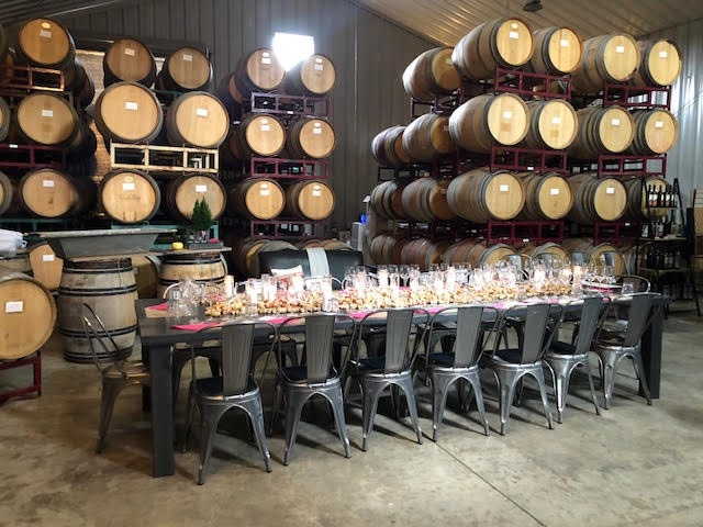Distant Cellars tasting room set up for a Valentine's luncheon. The table is decorated with wine corks and candles.