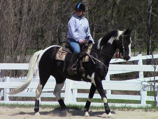 Sharon and Stetson riding in a Cowgirl Boot Camp