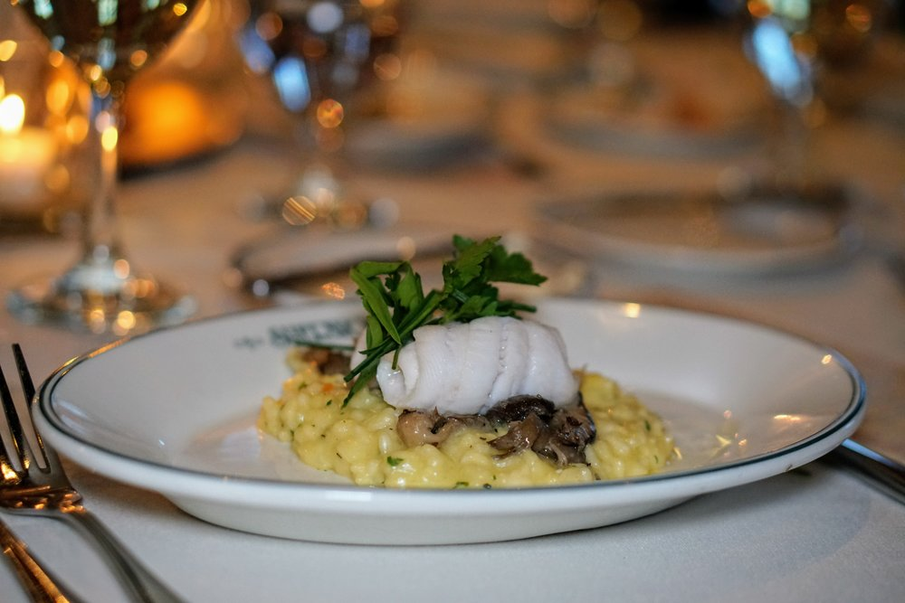 Lemon sole with wild mushrooms, saffron risotto, and fines herbs