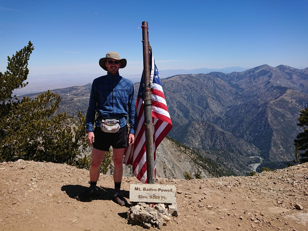Picture with the flag on the summit.