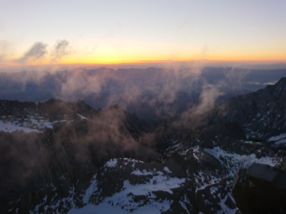 Early glimpse of the sunrise at the summit