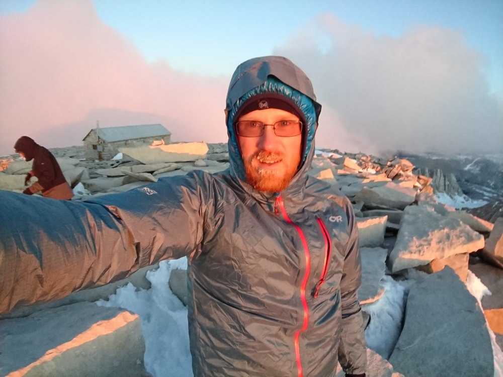 Early morning selfie in some of the first rays of sunshine at the Mt Whitney summit.