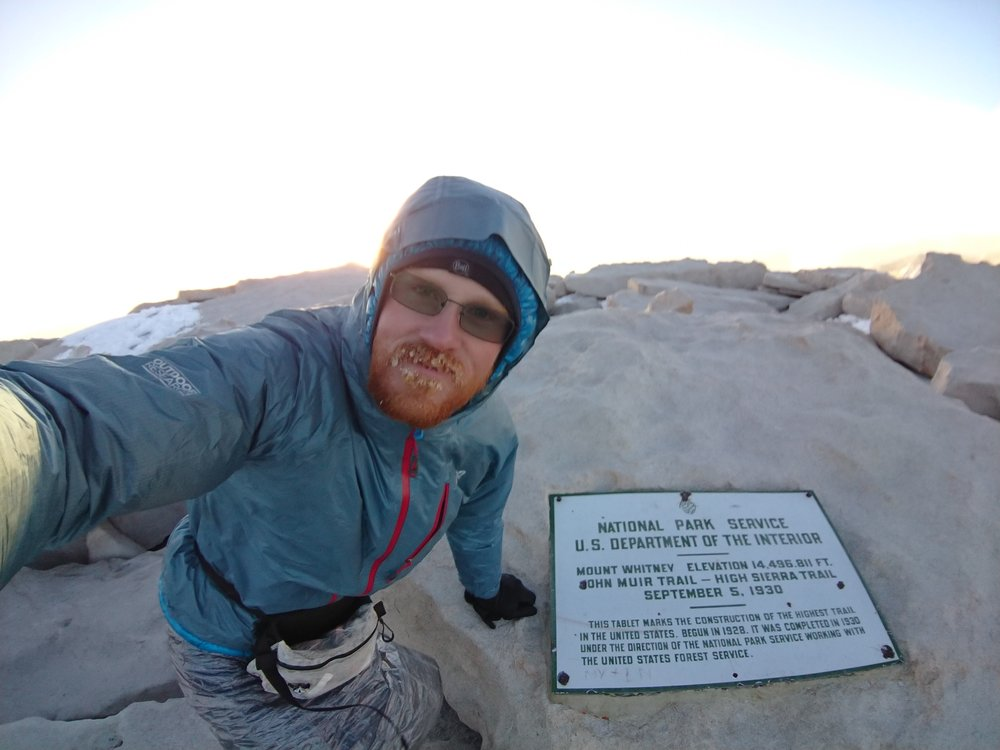 Frozen selfie with the plaque at the summit