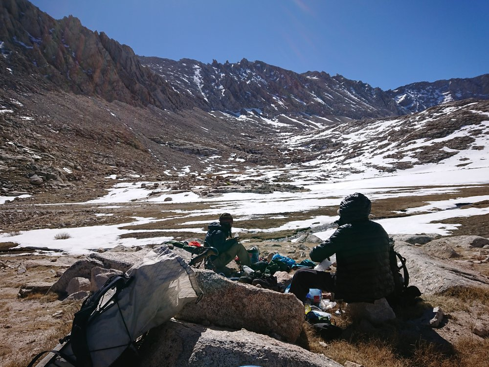 Taking a break at Guitar Lake while looking back at Mt Whitney