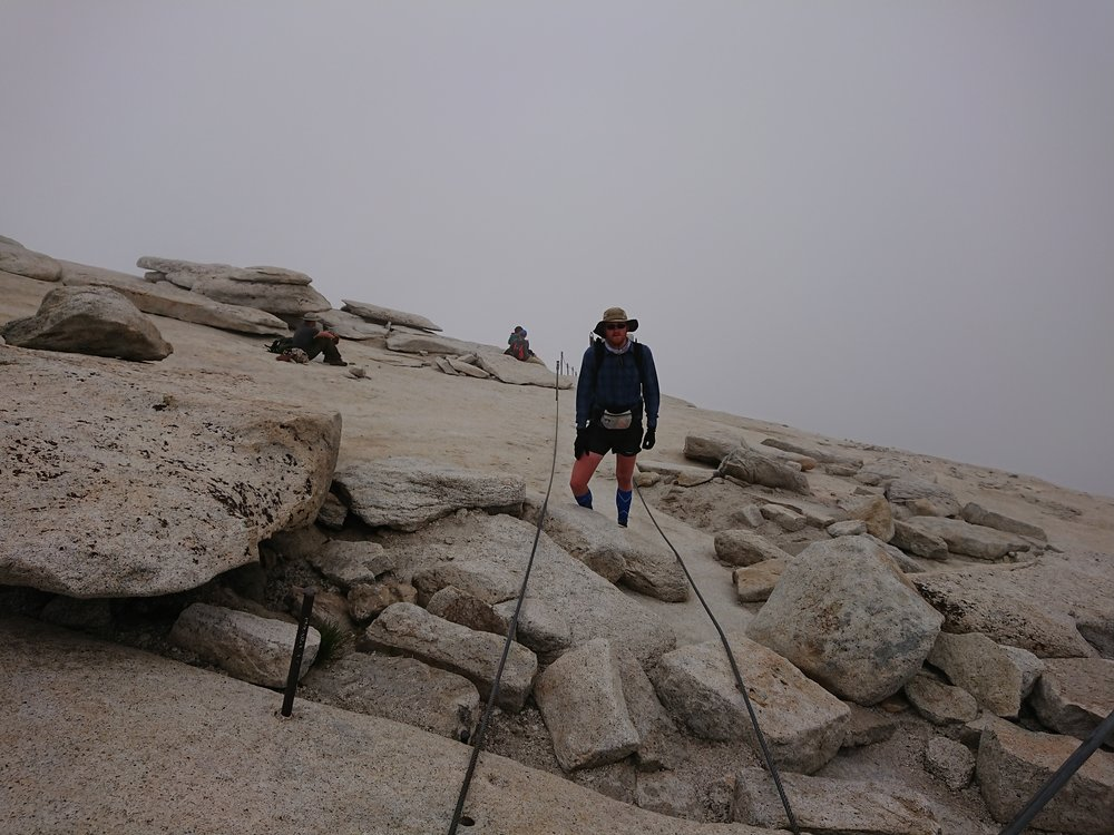 On the top of Half Dome completely envelope in clouds