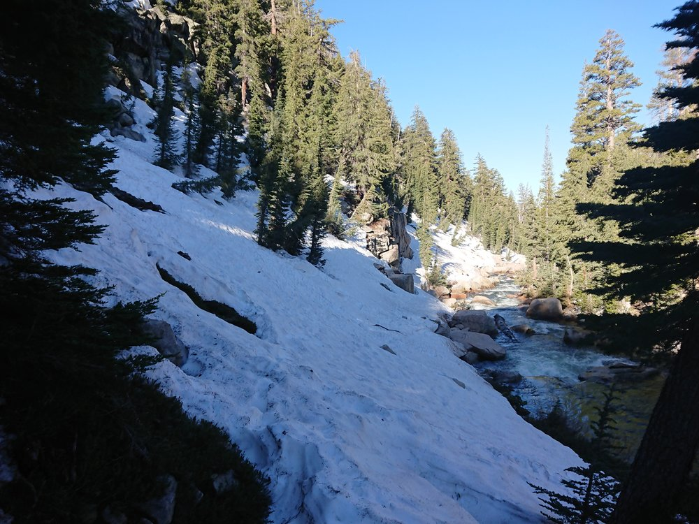 Very steep difficult snow slope to traverse with runoff straight into a creek
