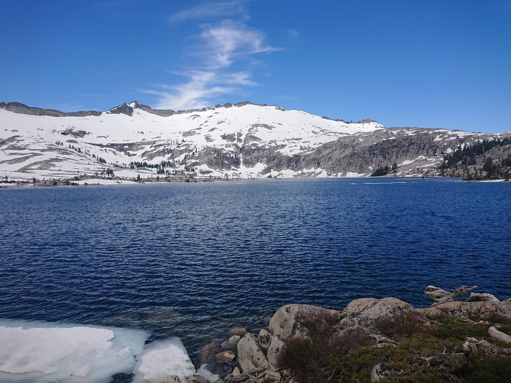 Lake Aloha is beautiful with the snow covered mountains as a backdrop