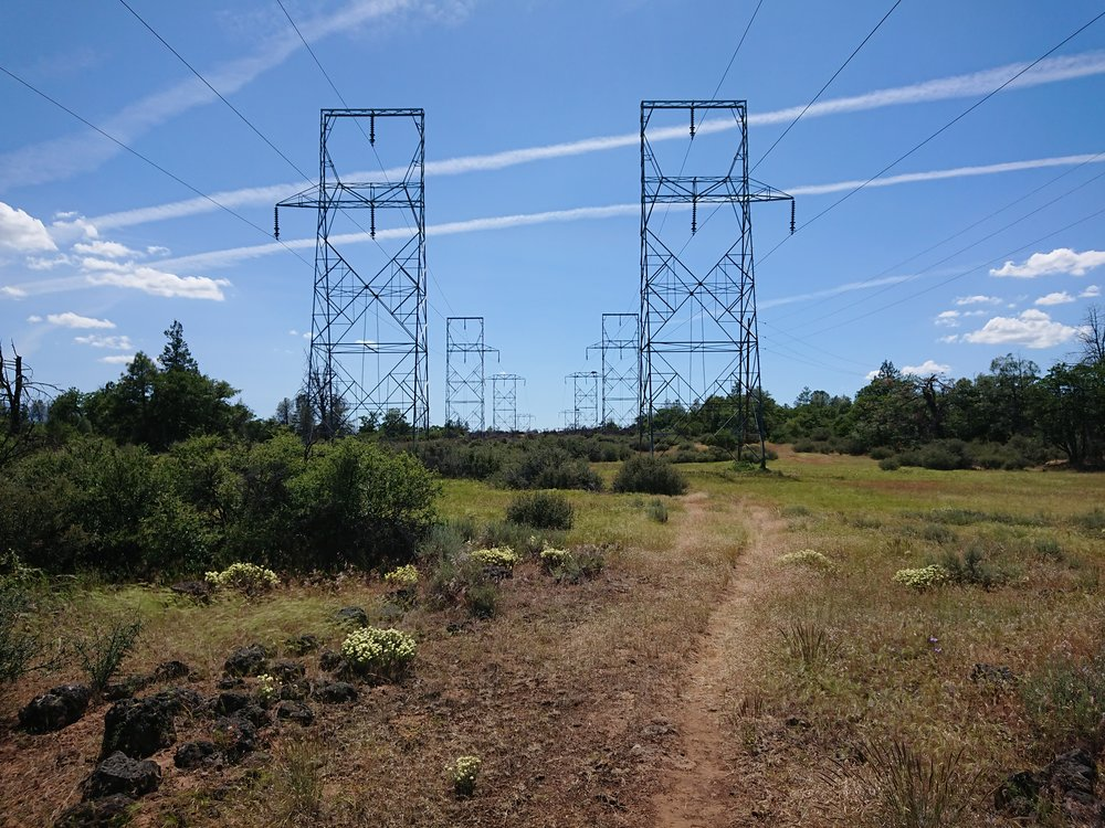 The side trail to the ranch followed the power lines