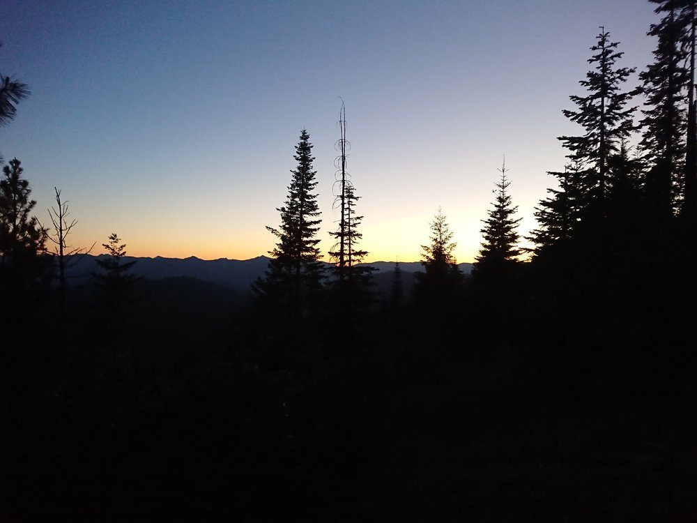 Sun below the mountains in the darkness