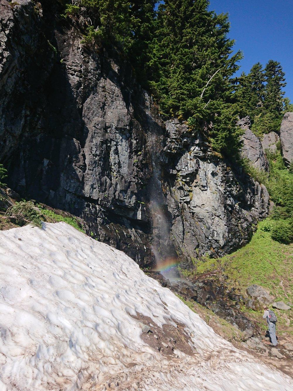 Small waterfall with rainbow near Chinook Pass