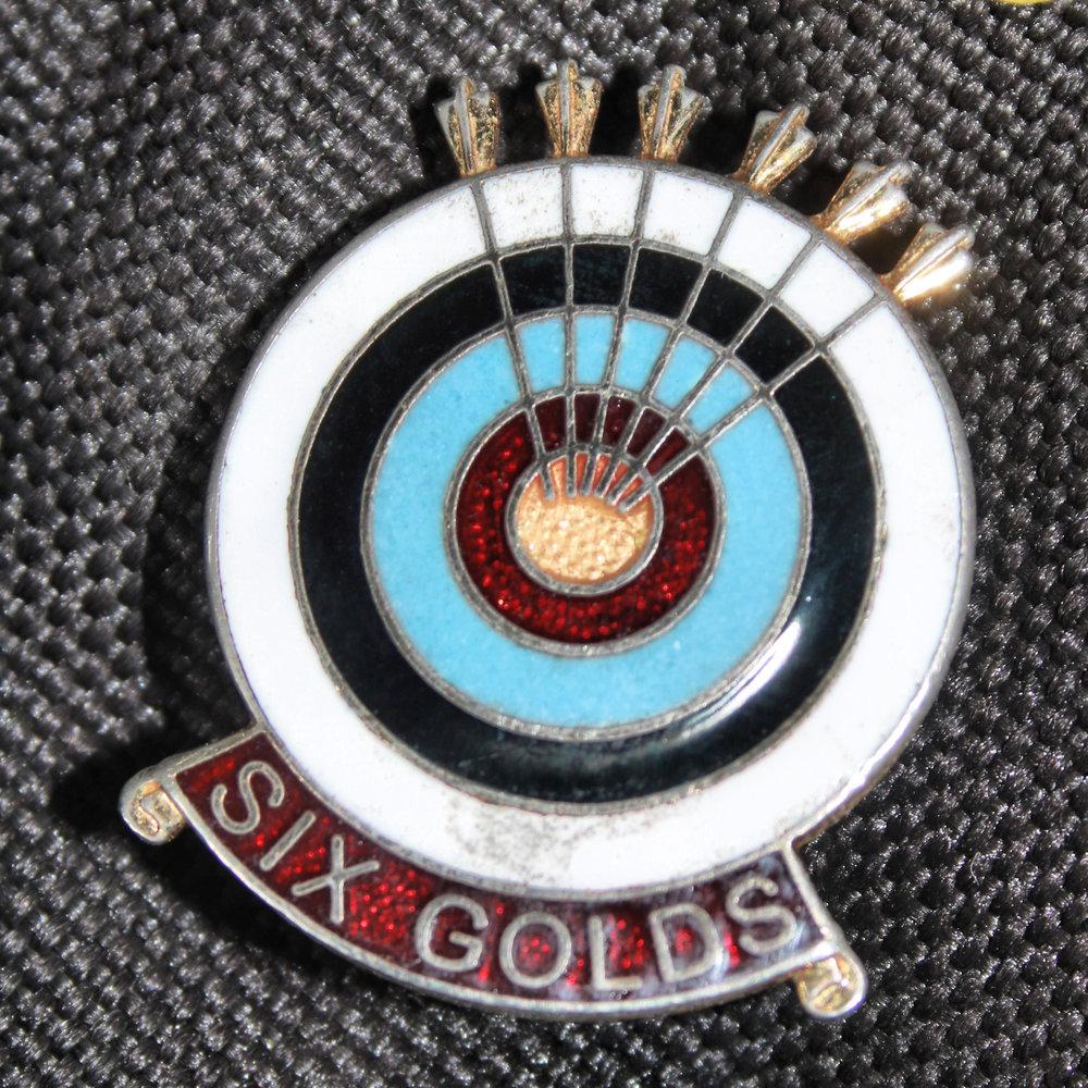 6 gold end badge.jpg