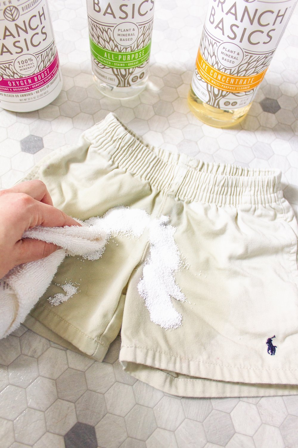 STEP THREE: Agitate by lightly rubbing with a washcloth - Agitate the stain by lightly rubbing it with a washcloth, activating the enzymatic reaction that takes place to lift + remove the stain.