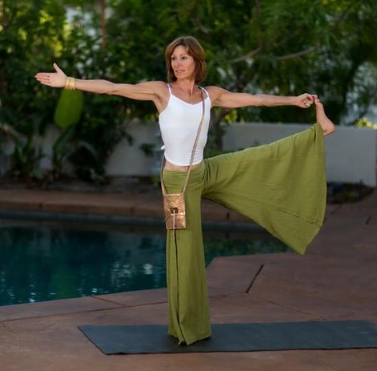 Rancho Mirage Yoga Teacher wearing a V&G custom bag during a fashion shoot.