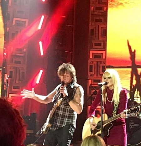 Richie Sambora performs in one of his many V&G guitar straps while wearing his V&G leather cuff.
