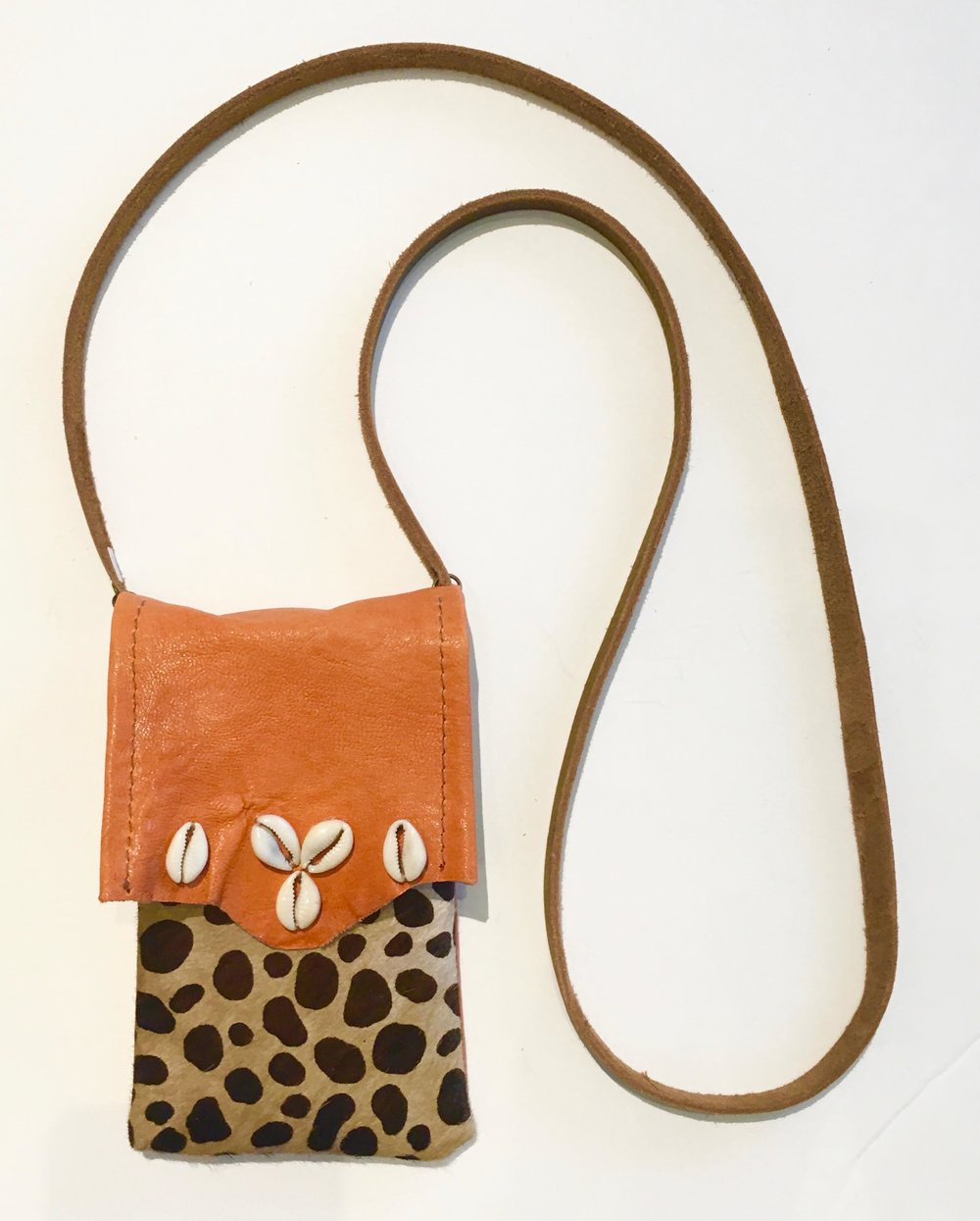 Hair on hide cross body bag with coral lambskin flap embellished with seashells.  $128..jpg