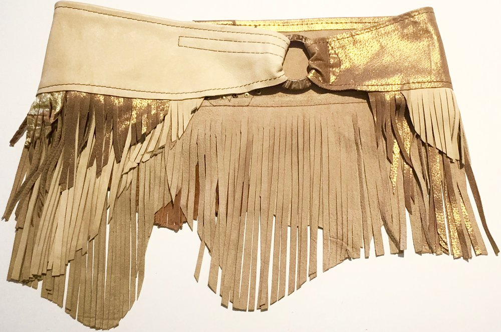 Light tan and metallic gold lambskin.  Layered fringe and gold colored stud work. Coconut ring with adjustable velcro closure.  $380.jpg