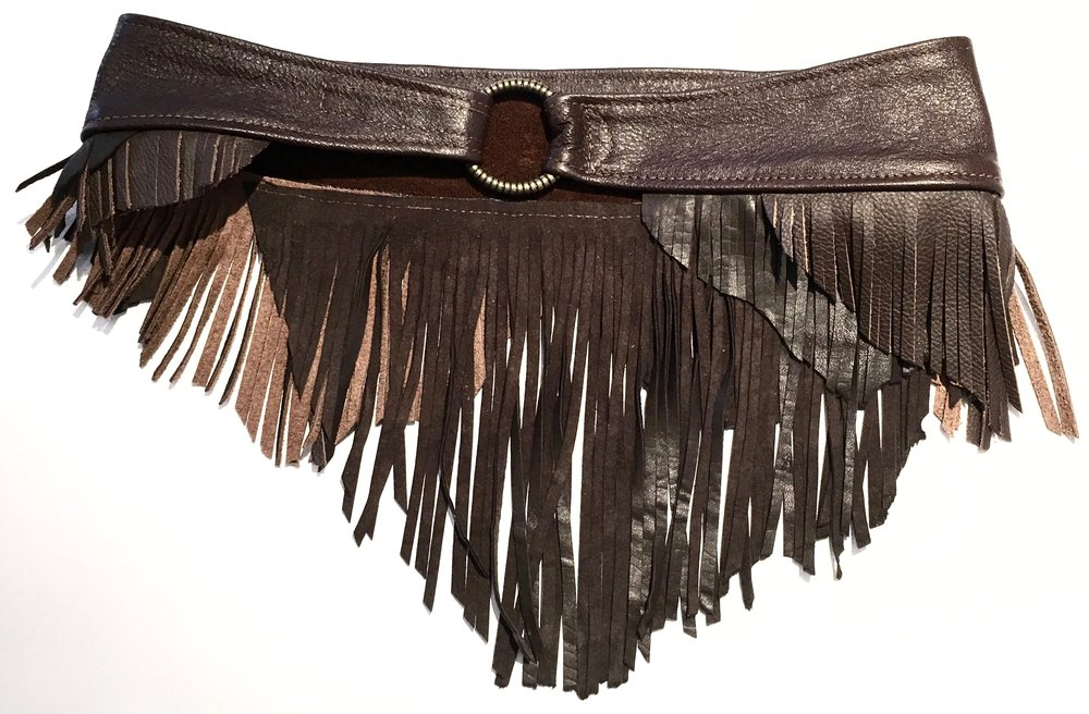 Shades of brown cowhide and lambskin with layered fringe.  Brass ring with adjustable velcro closure. $348..jpg