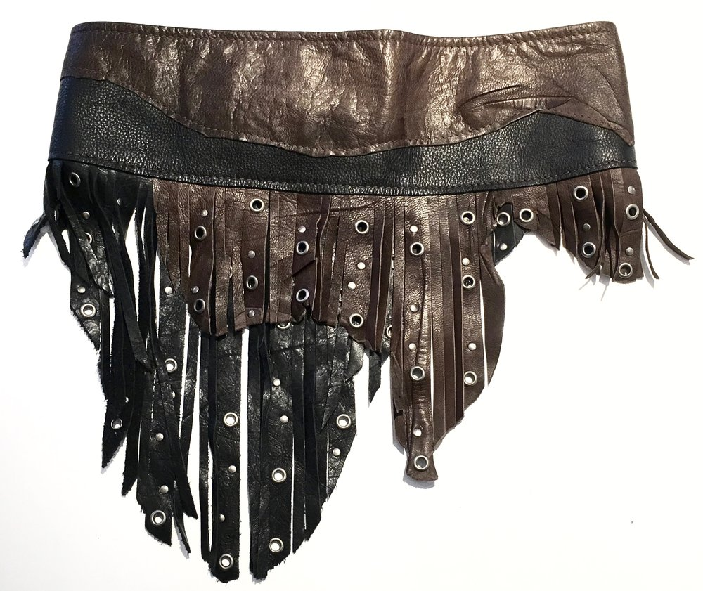 Black and brown cowhide with layered fringe and antiqued nickel metal work. Back view.jpg