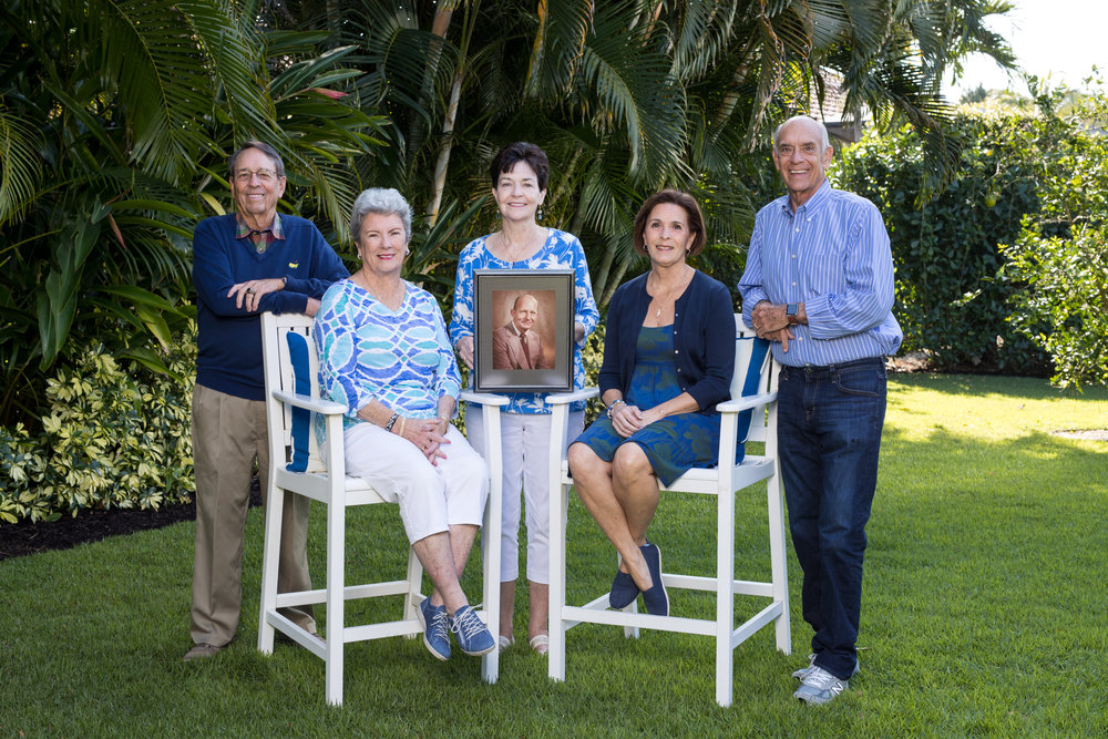 Henry E. Haegg, Jr.'s five stepchildren are carrying on his legacy through donor-advised funds created in their names at the Community Foundation of Collier County. Pictured are Larry Halpin, Cathy Munsell, Kathleen Halpin ( holding picture of stepdad Henry E. Haegg), Molly Eovino, and Jamey Halpin
