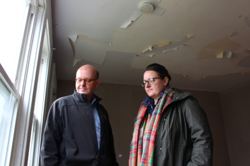 Central New York Community Foundation CEO Peter Dunn and Katelyn Wright, executive director of the Syracuse Land Bank, tour a land bank property that will need lead remediation. Photo courtesy of the Central New York Community Foundation.