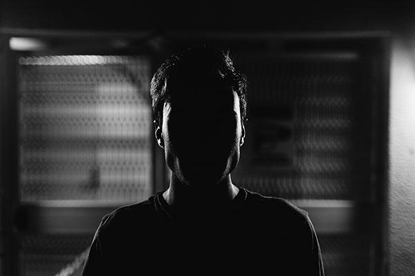 Faceless Man in dark shadows
