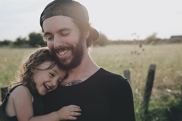 Father hugging daughter at a farm