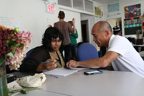Man teaching woman in a classroom