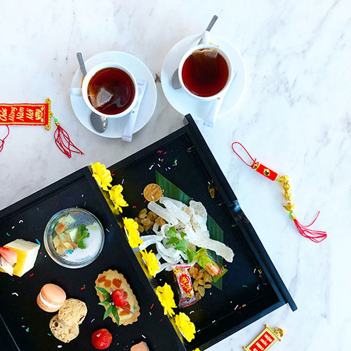 Lunar new year celebration with desserts and chinese tea