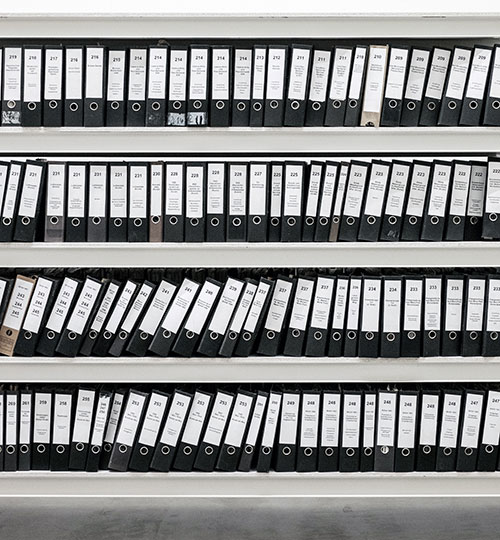 four rows of files stored on shelf