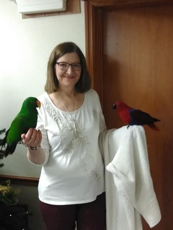 holiday party 2018 Janet w parrots.jpg