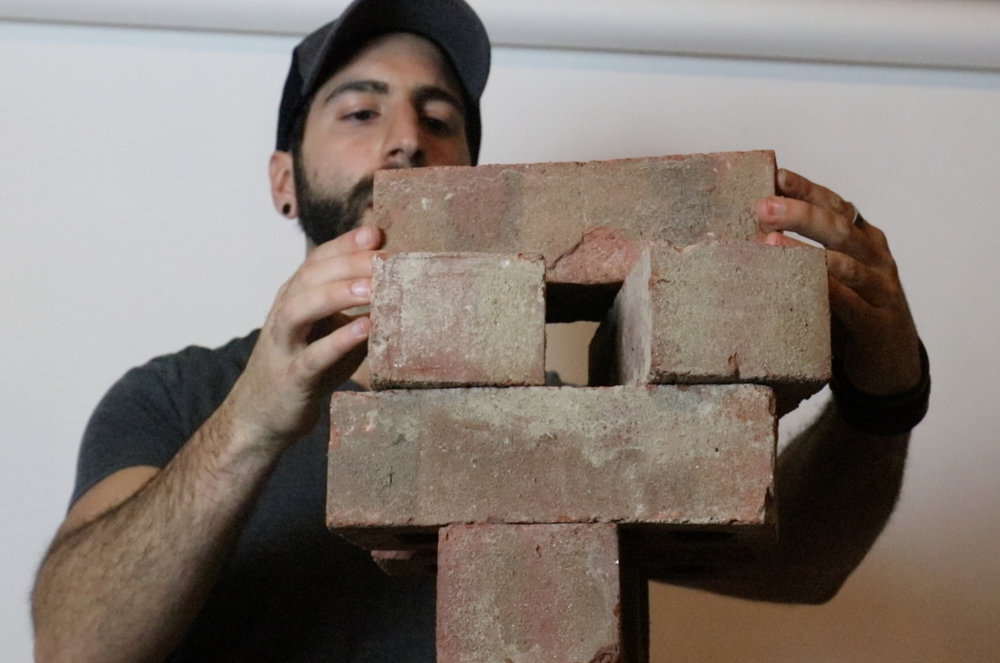Carefully stacked the bricks. A version of Jenga with real consequences!