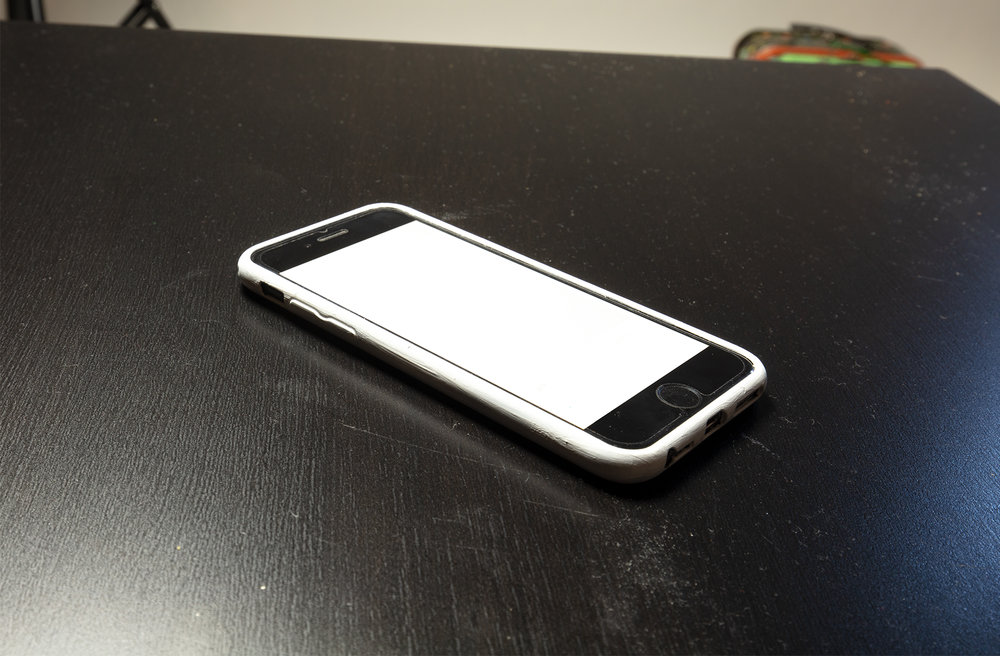 An iphone with a white case was used for the phone rafts.