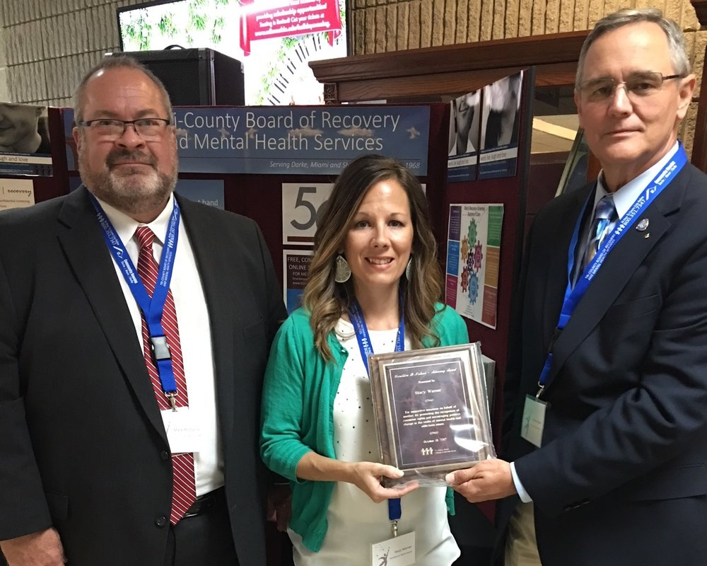 - On October 18, 2017, the Tri-County Board of Recovery & Mental Health Service presented Stacy with the Geraldine B. Nelson Advocacy Award for her work with Free the Mind/Anchor the Soul, Inc. This award is given to individuals for providing support on behalf of another by promoting the recognition of consumer rights and encouraging positive change in the realm of mental health issues.