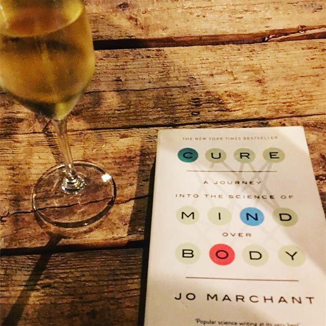 """Casual #wednesday #eve reading the fascinating """"science of the kind over body."""" With the obligatory #cava of course! Amazing the effect of #positivethinking and #placebo can do to a whole host of issues! #heal #health #learned"""