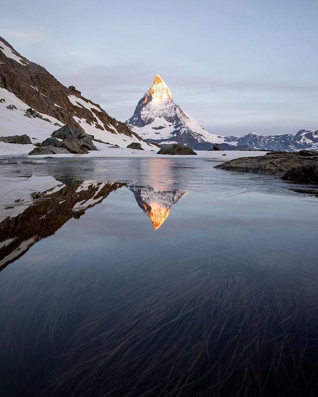 Today I woke up with this view: the Matterhorn and it's reflection in the Riffelsee. After a pretty cold night (-5°C) at 3000+m elevation a dream came true. I always wanted to shoot an epic sunrise somewhere high in the mountains. Fullfilling this dream at a location like this is something I will never forget. Only an hour later I shot a huge cloud inversion. It was a prefect morning! @zermatt.matterhorn • @canonbelgium @loweprobags @visitswitzerland @myswitzerland @earthfocus • #createcommune #way2ill #shoot2kill #agameoftones #theimaged #justgoshoot #citykillerz #moodygrams #createexploretakeover #createexplore #streatdreamsmag #fatalframes #exploreeverything #ACreativeVisual #yngkillers #artofvisuals #communityfirst #mkexplore #visualsoflife #thecreatorclass #hbouthere #architecture #urban #featuremeinstagood #vscocam #photooftheday #loves_united_urban #illgrammers #killeverygram