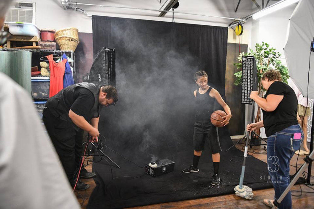- Here, Heidi and Andrew are starting to get a little more creative, adding some additional elements to their image (in this case, with the use of a fog machine that's usually only seen outside photography studios around Halloween).